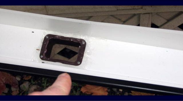 Gutter drop outlet closeup